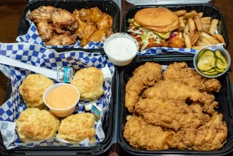 Boss Bird Kitchen to go order with chicken sandwich, wings, and tenders