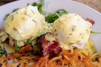 Crispy Parmesan Risotto and Honey Cured Bacon Eggs Benedict at Shorehouse Kitchen in La Jolla