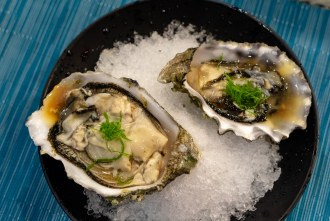 Puget Sound oysters course during omakase at Too Sushi Project