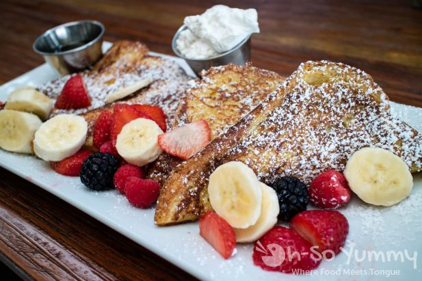 french toast with bananas mixed berries and cream at bushfire kitchen in del mar california - Bushfire Kitchen