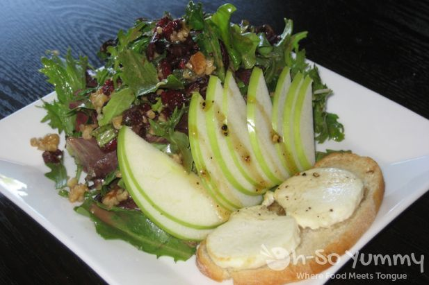Warm Goat Cheese Salad with Crostini, Spring Mix, Apple, Walnut & Peppered Honey