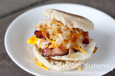 Super Bacon, Fried Egg, Cheddar Cheese, Hash, and English Muffin Sandwich