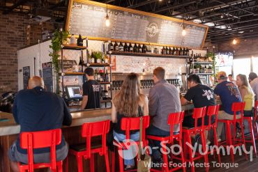 Bar seating at Common Theory Public House in San Diego