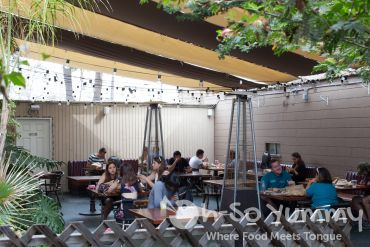back patio seating at Evolution Fast Food in San Diego
