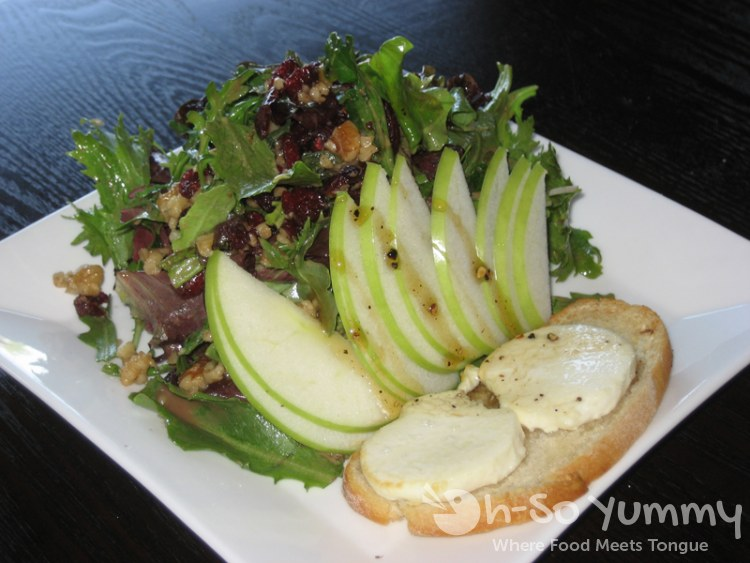 Warm Goat Cheese Salad with Crostini, Spring Mix, Apple, Walnut and Peppered Honey