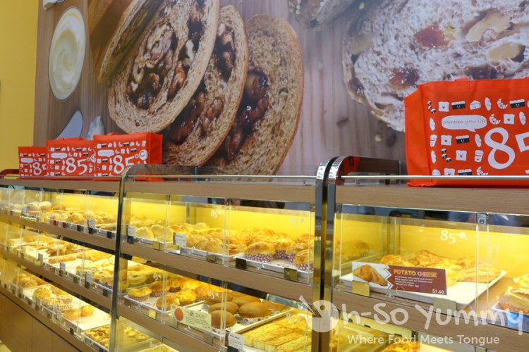 wall of bakery goods at 85C Bakery Cafe in San Diego