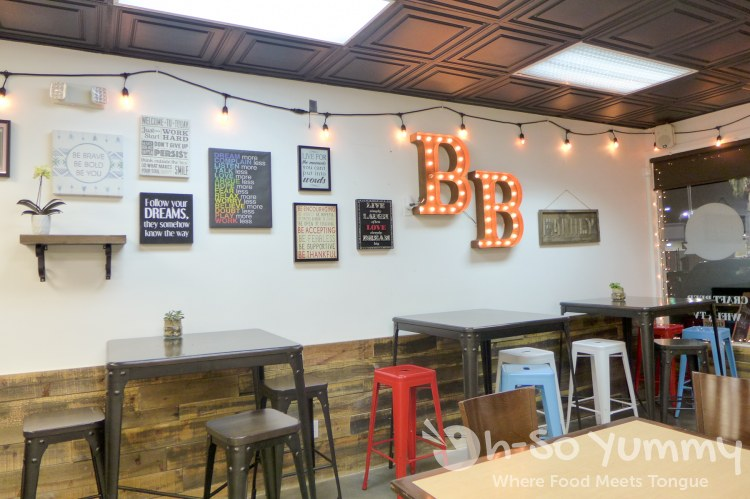 wall and dining area of Baguette Bros