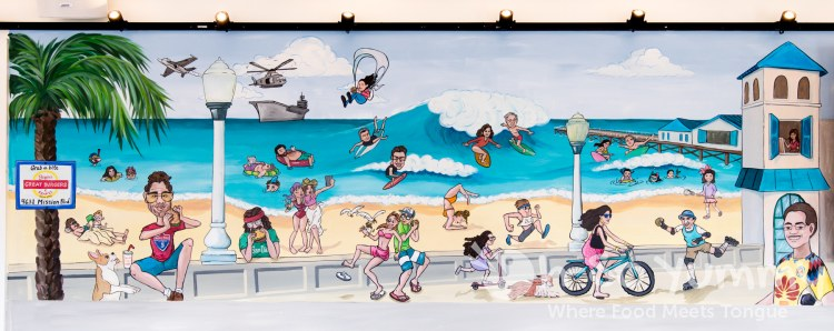 mural of Pacific Beach on wall inside Biggie's Burgers restaurant in San Diego