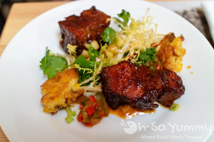 Hanis Cavin with The Pioneer BBQ served Smoked Pork Belly Burnt Ends