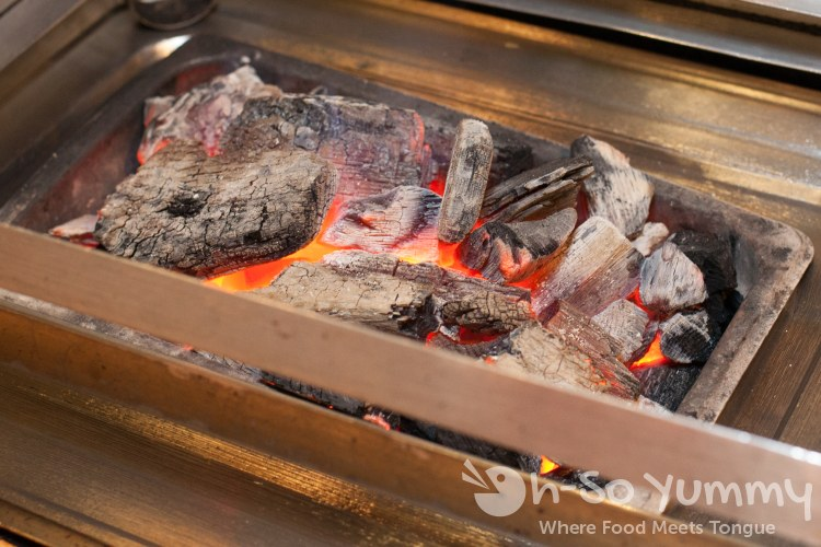 charcoal under grills at Dae Jang Keum