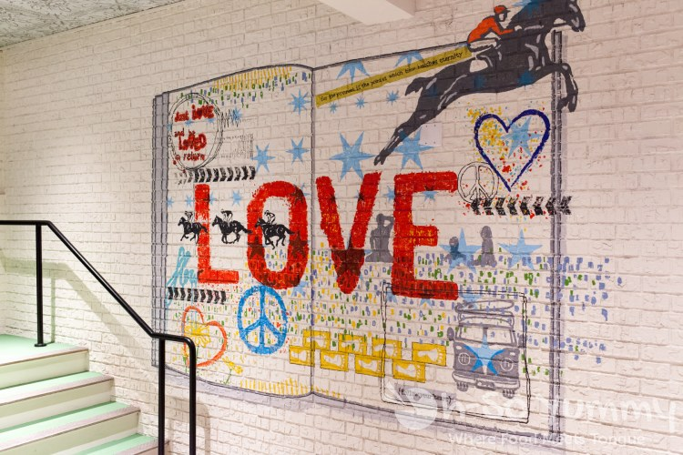 love art on the wall at Flower Child (Flower Hill Promenade) in Del Mar