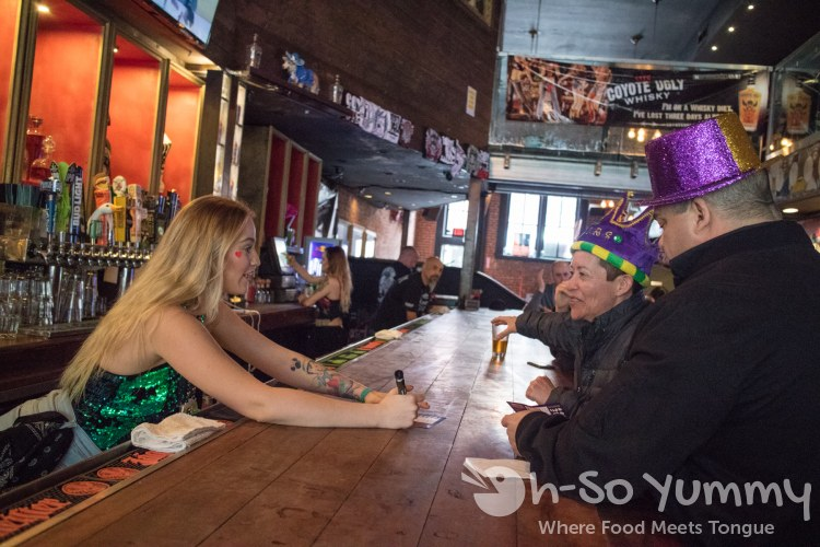 Coyote Ugly serves customers for Gaslamp Mardi Gras Beads Bites and Booze Tour