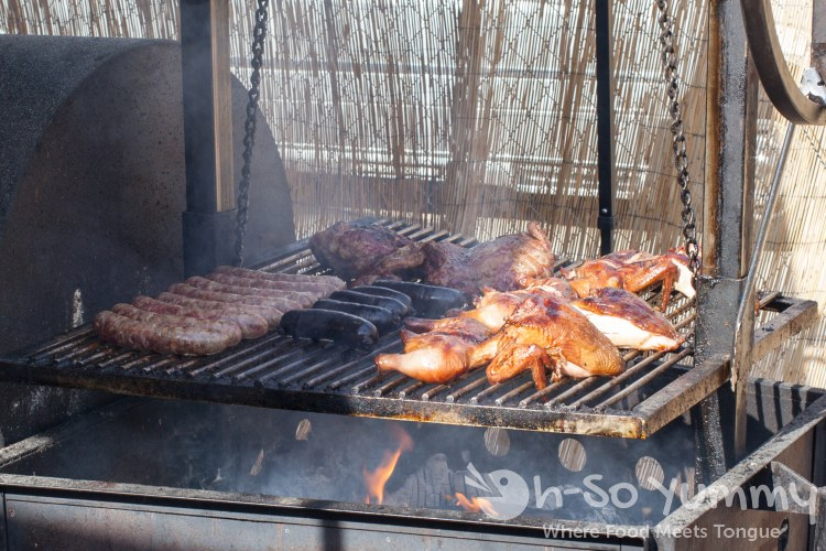 grilling meat at Grand Ole BBQ Y Asado