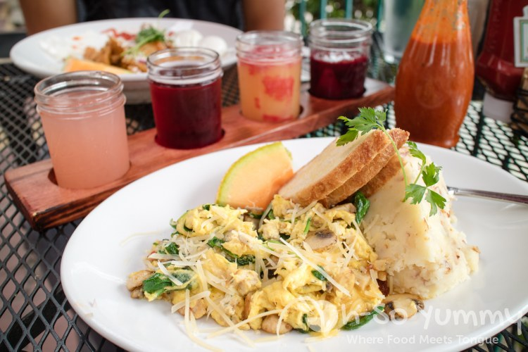 Tres Egg Scramble and mimosa flight at Parkhouse Eatery in San Diego