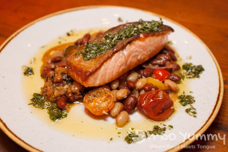 salmon with beans tomatoes and salmoriglio at searsucker