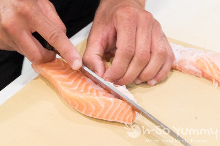 Salmon belly preparation at Single Fin Kitchen inside Atlas Market in Poway