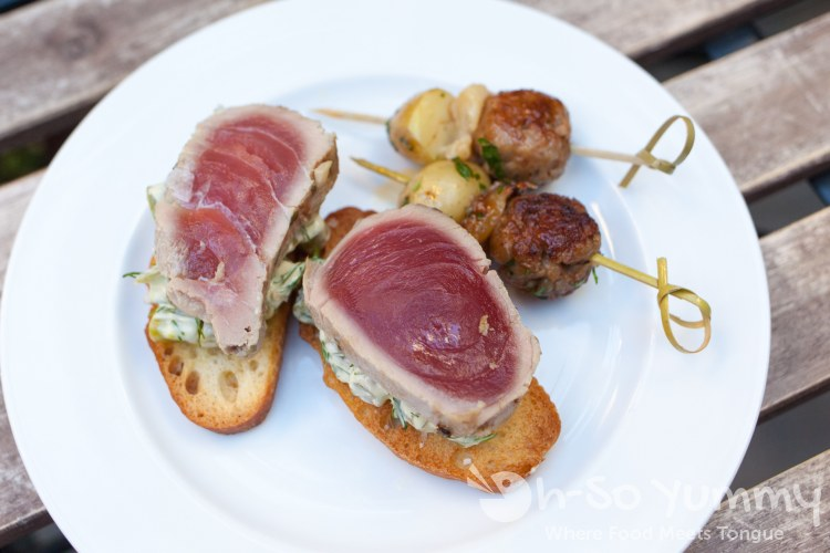seared ahi crostini, sausage and spicy potatoes