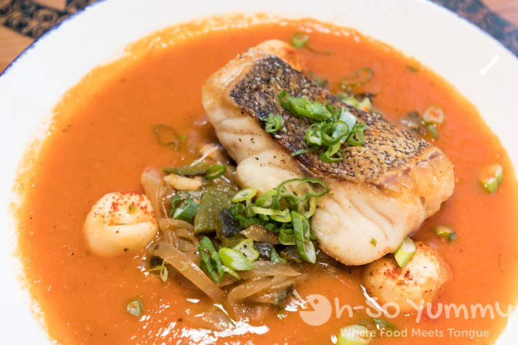 Sea Bass in smoked tomato broth at Waterbar in Pacific Beach of San Diego
