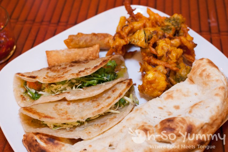 tikka taco, vegetable pakora, phall popper, naan at World Curry in Pacific Beach