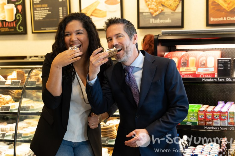 Jessica McGehee and Neil Strong taking a cookie bite