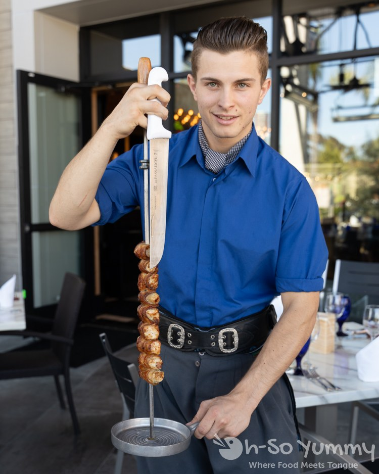 meat served from a skewer at Texas de Brazil churrascaria in The Shoppes at Carlsbad